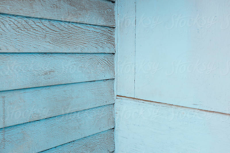 Corner of painted blue wall by Paul Edmondson for Stocksy United