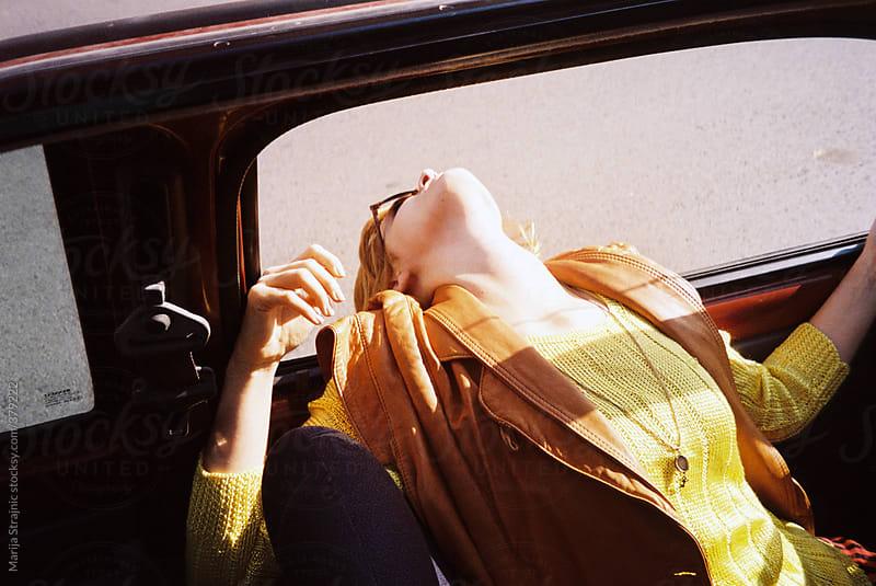Sunbathing girl by Marija Strajnic for Stocksy United