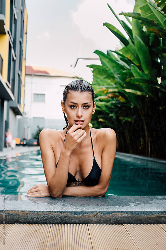 Portrait of a Sexy Woman With Wet Hair Looking at Camera by Nemanja Glumac for Stocksy United