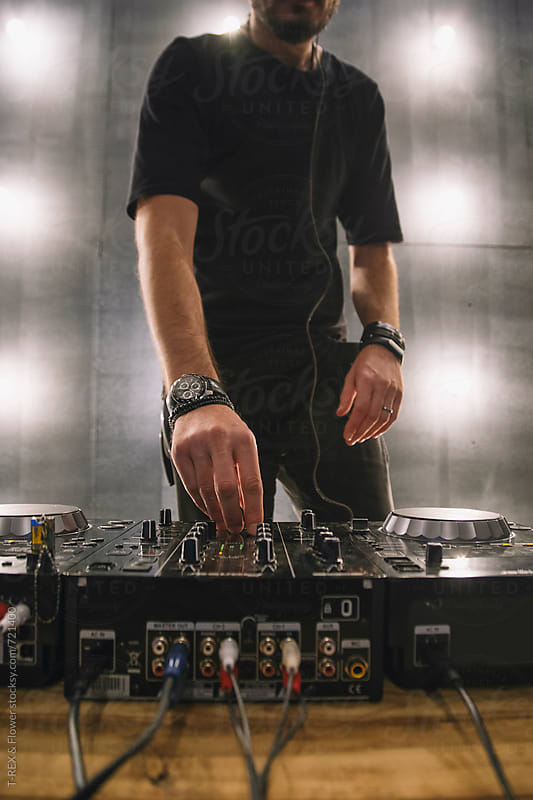 Closeup of Dj's hands by Danil Nevsky for Stocksy United