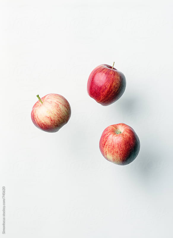 Three organic red apples by Simonfocus for Stocksy United