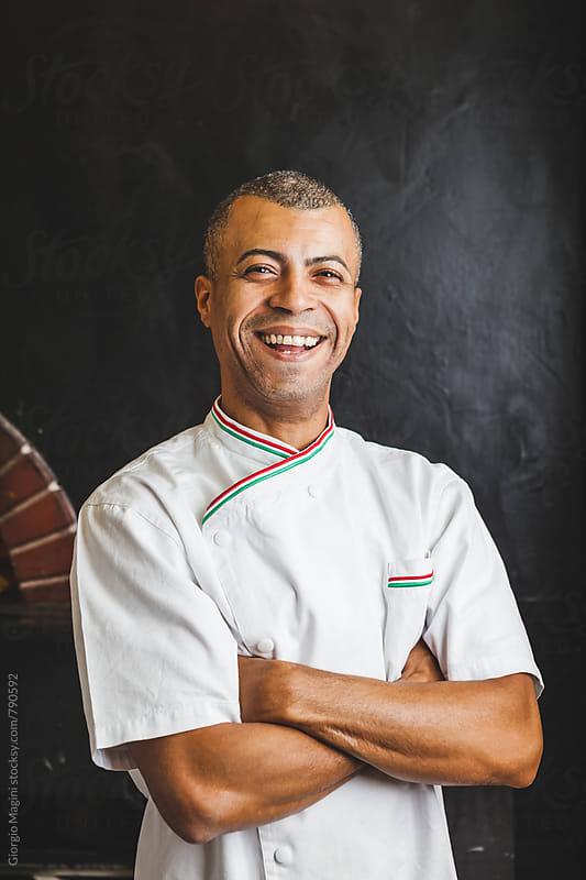 Mixed Race Happy Chef in Italian Pizzeria by Giorgio Magini for Stocksy United