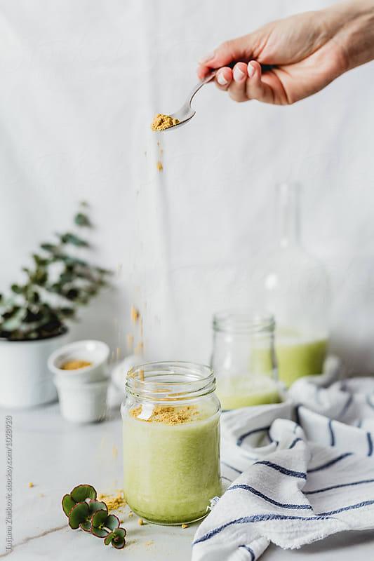 Melon smoothie with pollen by Tatjana Zlatkovic for Stocksy United