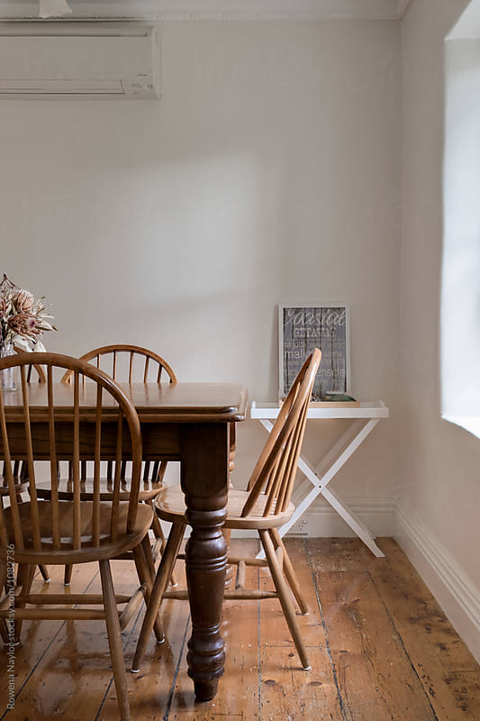 Timber dining table with chair in country cottage
