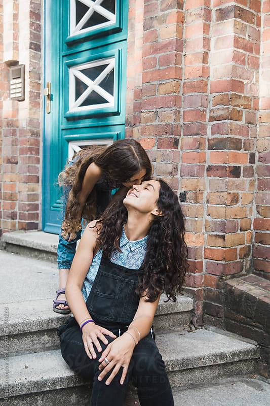 Girl kissing her mother by Irina Efremova for Stocksy United