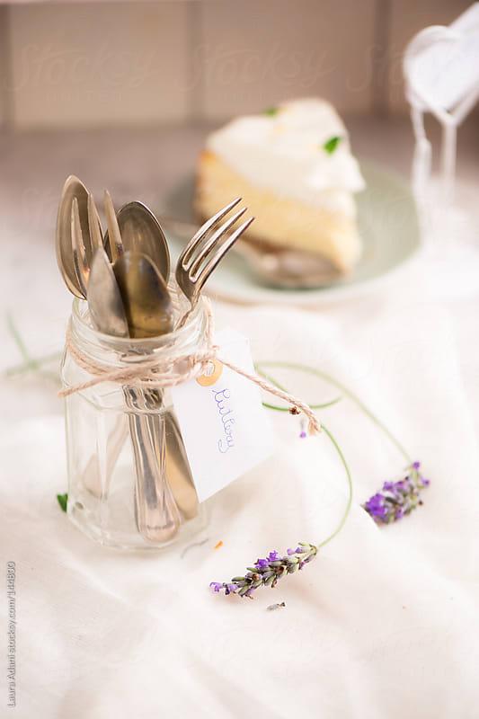 cutlery in a glass jar by Laura Adani for Stocksy United