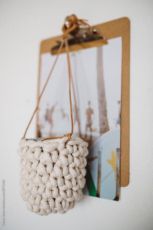 Handmade white rope hanging planter by Carey Shaw for Stocksy United
