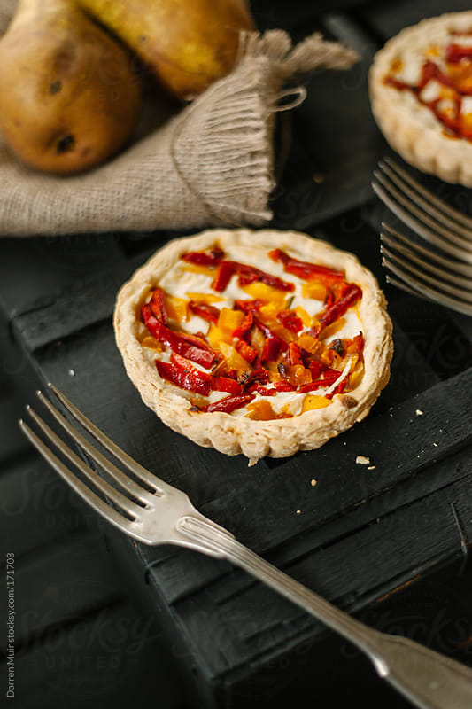 Goats cheese tarts. by Darren Muir for Stocksy United