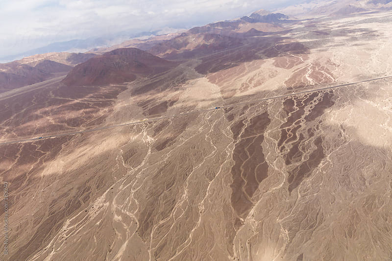 Dry river beds and Panameicana in Nazca Peru seen from air plane by Ben Ryan for Stocksy United