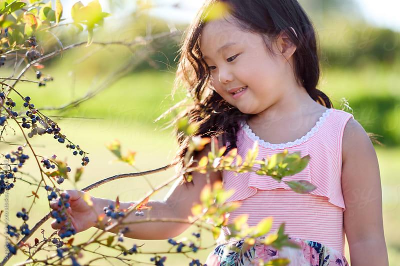 Happy Asian girl outdoor in a park by Suprijono Suharjoto for Stocksy United