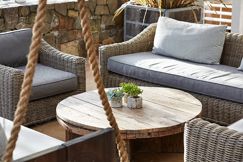 Outdoor lounge on patio at upscale restaurant  by Trinette Reed for Stocksy United