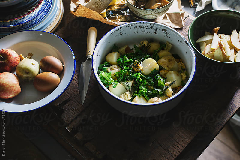 Preparing a dish of smoked mackerel,kale,potato and apple salad. by Darren Muir for Stocksy United