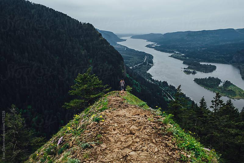 Woman Hiker Walking Down Mountain Ridge by Evan Dalen for Stocksy United