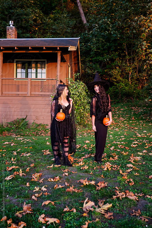 Beautiful women in witch costume celebrating Halloween by Suprijono Suharjoto for Stocksy United