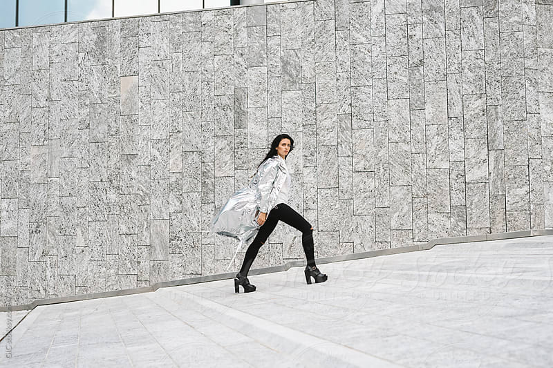 Stylish woman with a silver jacket by GIC for Stocksy United