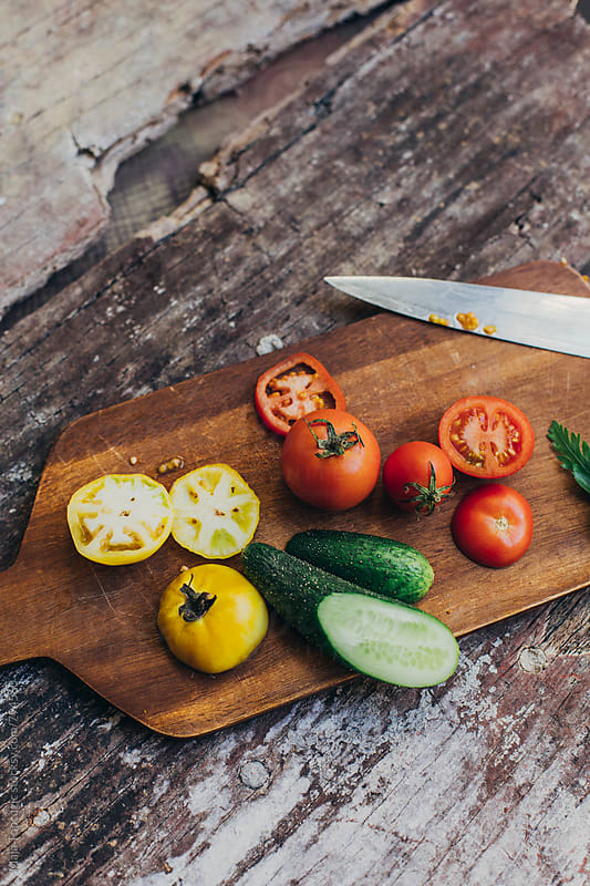 Prepairing a healthy salad by Maja Topcagic for Stocksy United