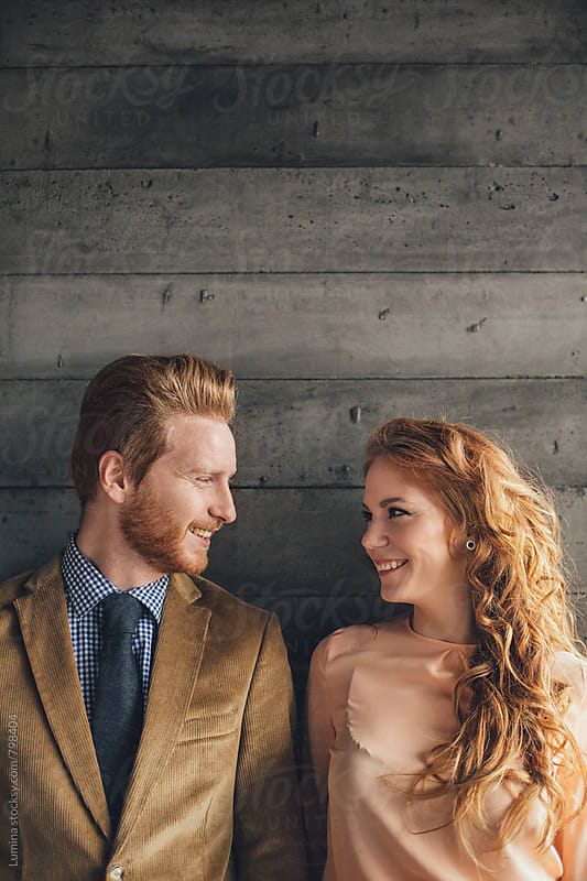 Ginger Couple Looking at Each Other by Lumina for Stocksy United