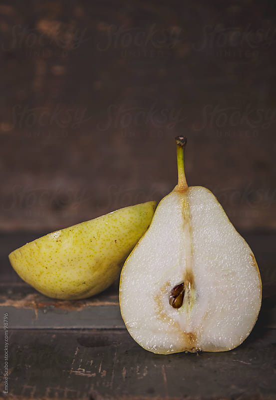 Pear cut in two pieces by Emoke Szabo for Stocksy United