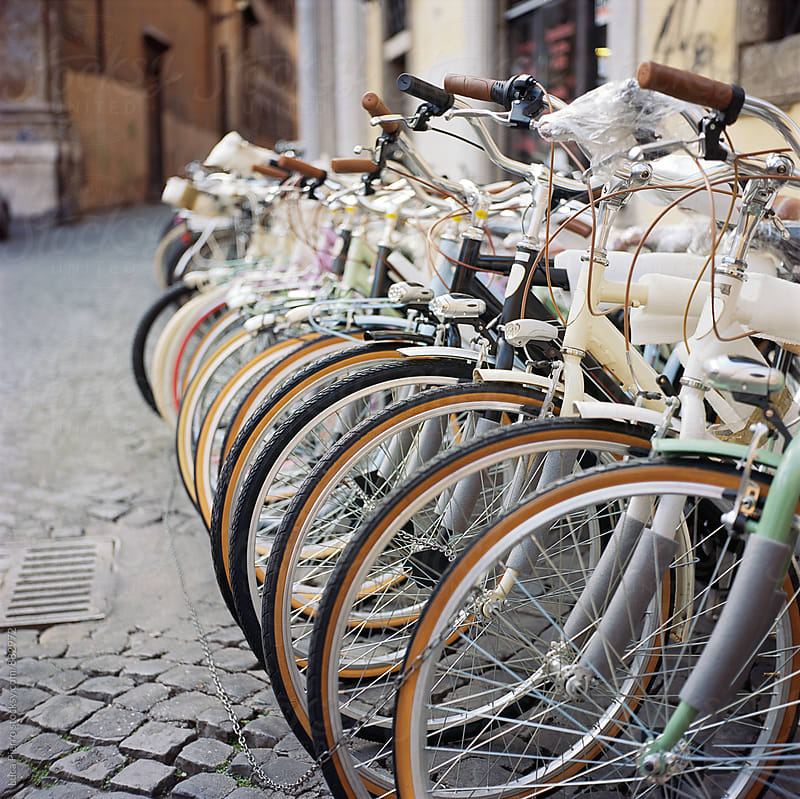 Bicycles in a row  by Luca Pierro for Stocksy United