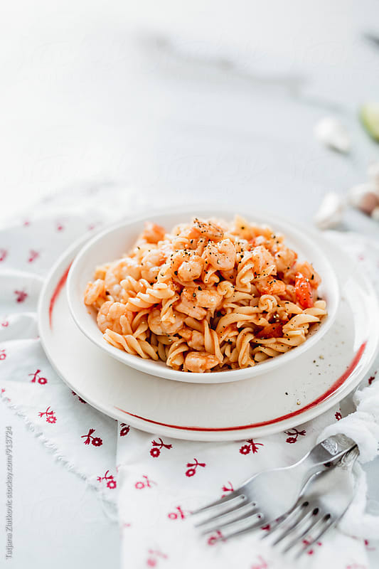Pasta with shrimp and tomato sauce by Tatjana Zlatkovic for Stocksy United