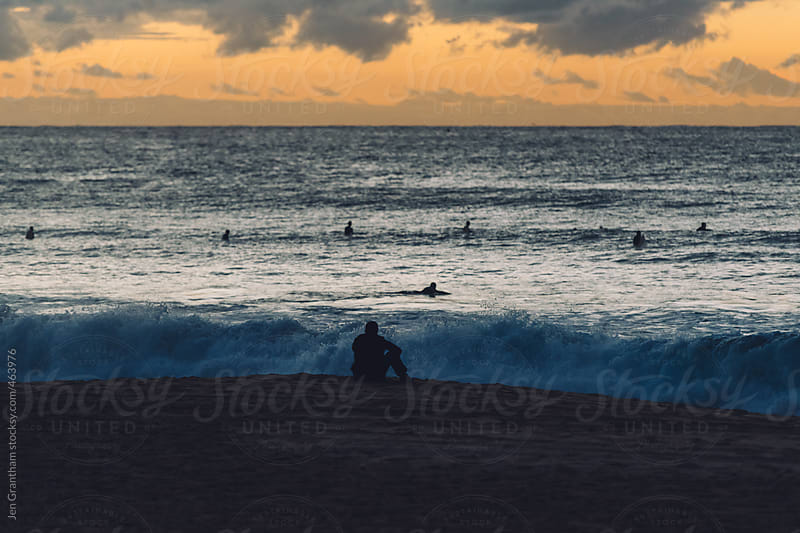Surfers heading out at sunrise on Bondi Beach by Jen Grantham for Stocksy United