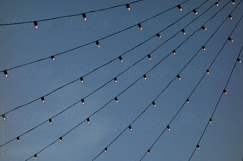 Patio Lights Against the Sky by Jeff Wasserman for Stocksy United