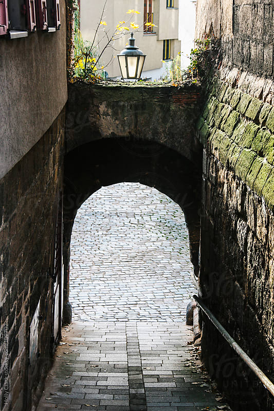 Closeup of an archway in an old German city. by Holly Clark for Stocksy United