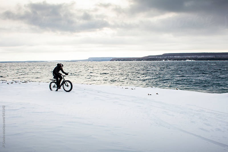 Extreme Winter Sport Mountain Biking on Snow and Ice by JP Danko for Stocksy United