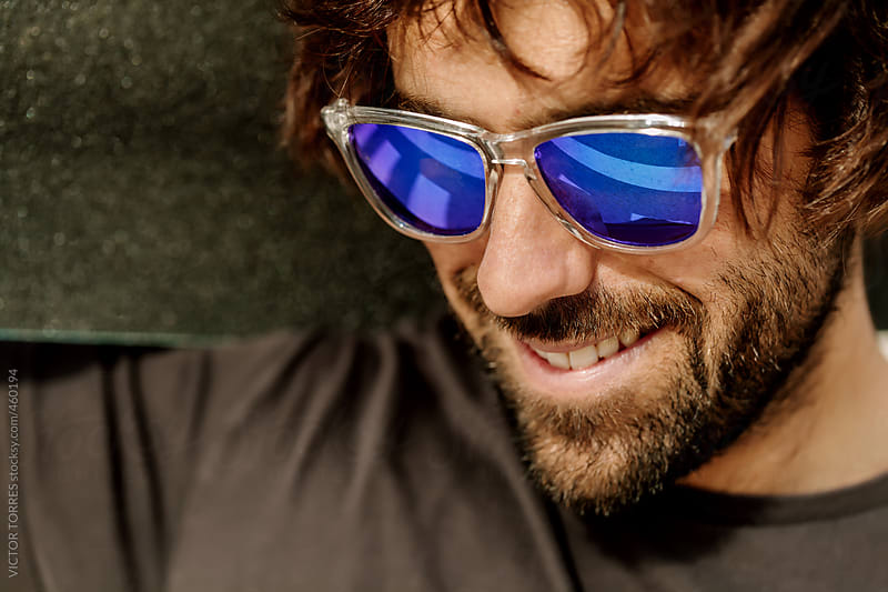 Portrait of a Young Hipster Man with Blue Sunglasses by VICTOR TORRES for Stocksy United