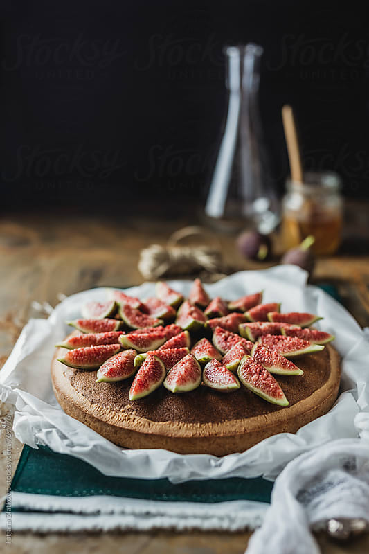 Fig tart with honey and hazelnuts by Tatjana Zlatkovic for Stocksy United