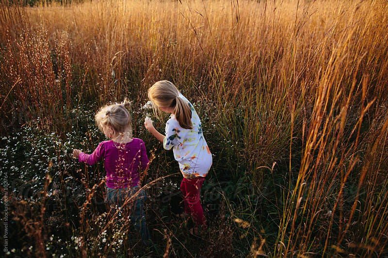 sisters exploring nature by Brian Powell for Stocksy United