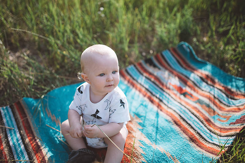 Baby Boy Playing with Grass by Kim Swain for Stocksy United