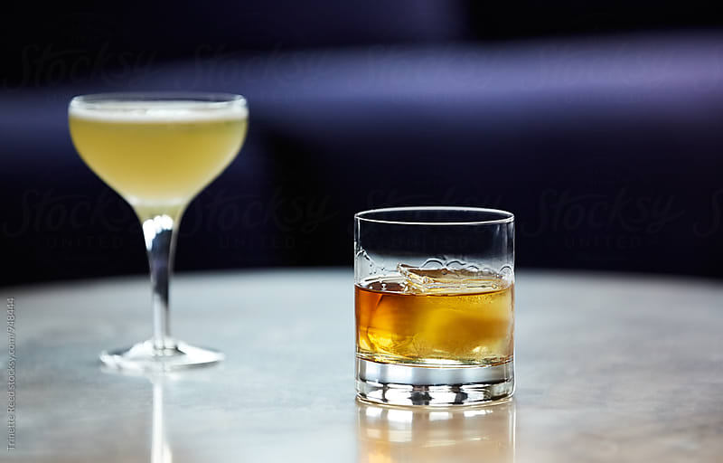 Two Cocktails in Bar Atmosphere by Trinette Reed for Stocksy United