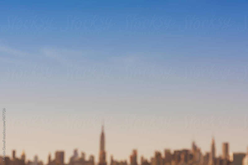 Defocused Manhattan skyline. New York City by Kristin Duvall for Stocksy United