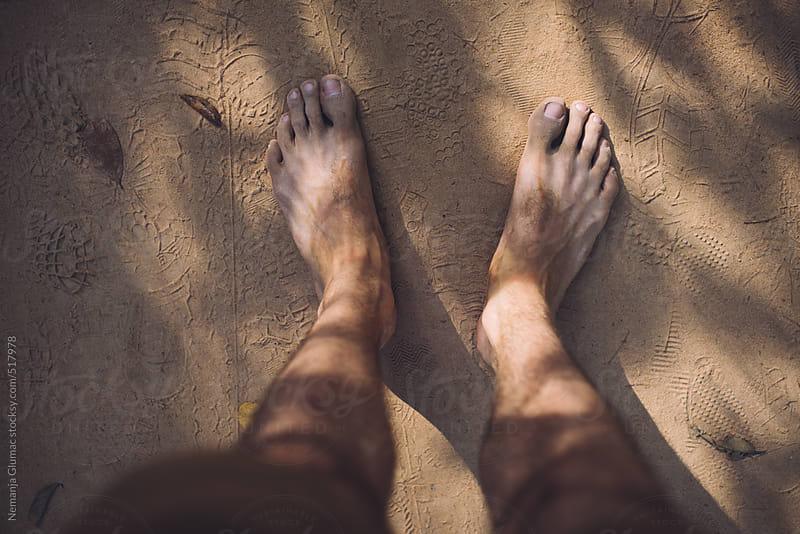 Male Bare Feet in Dust by Nemanja Glumac for Stocksy United
