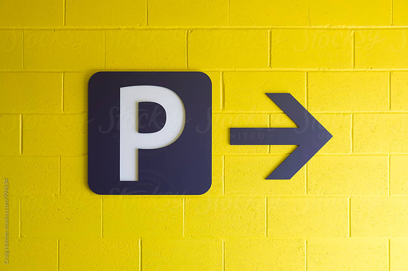 Signage for a car park by Craig Holmes for Stocksy United