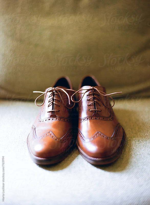 Brown wingtip shoes by Marta Locklear for Stocksy United