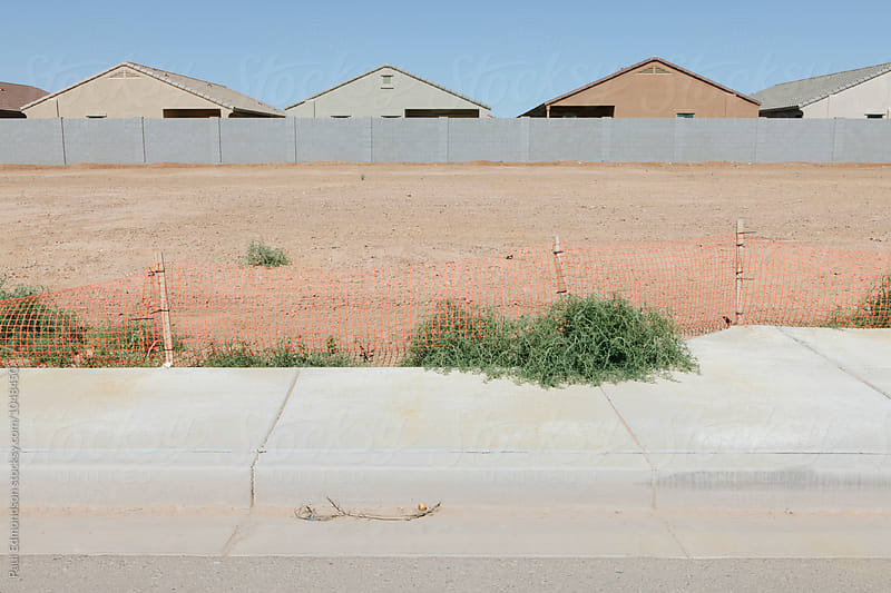 Partially completed suburban housing development on outskirts of Phoenix by Paul Edmondson for Stocksy United