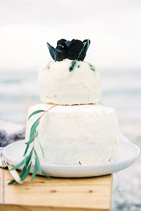 Beach themed wedding cake by Adrian Cotiga for Stocksy United