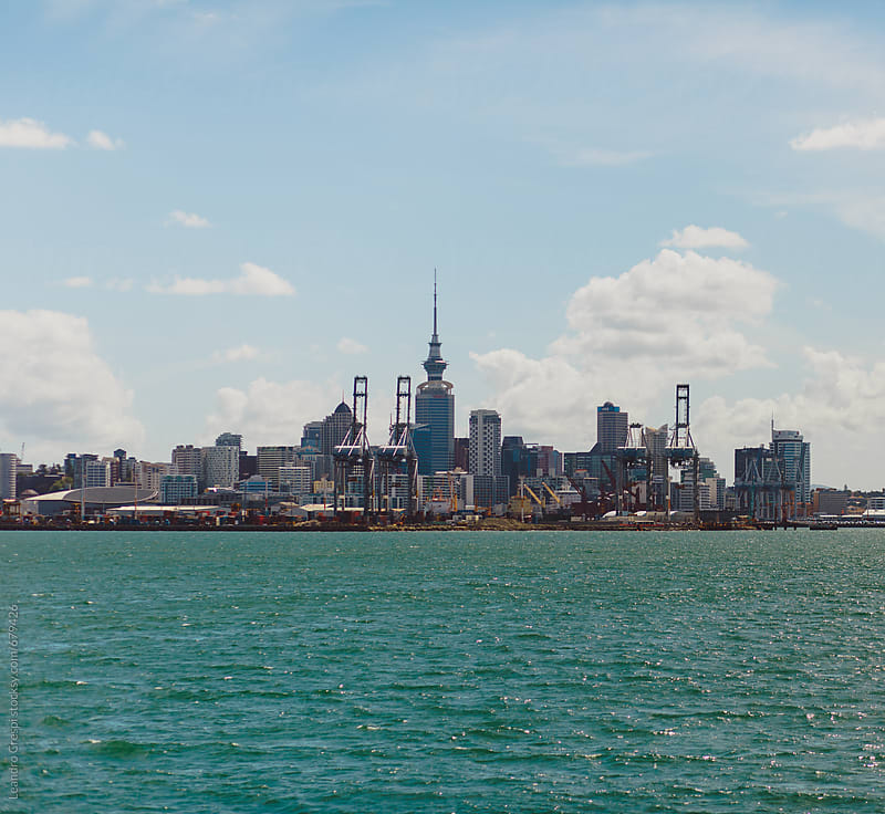 Views of Auckland city and famous tower from the water by Leandro Crespi for Stocksy United