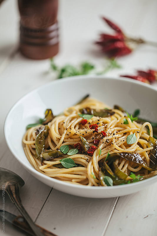 Spaghetti with peppers and basil by Davide Illini for Stocksy United