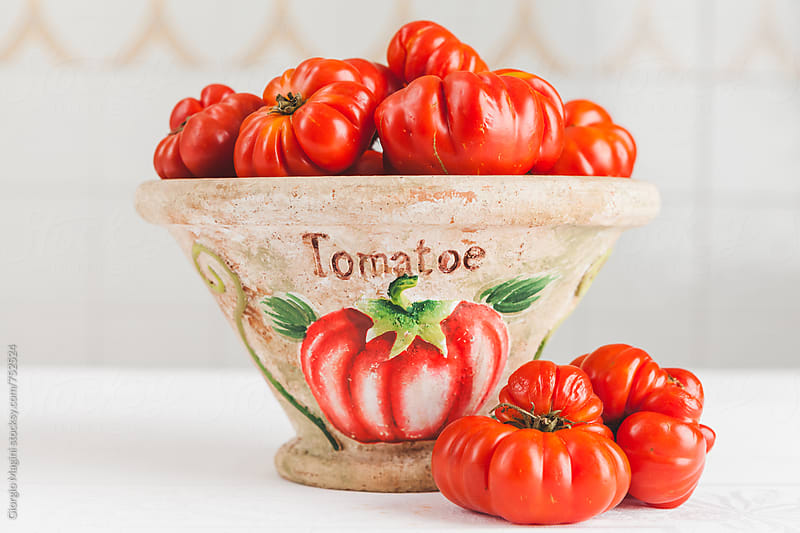 Fresh Florentine Ribbed Tomatoes on a Vase, Italian Costoluto Fiorentino by Giorgio Magini for Stocksy United