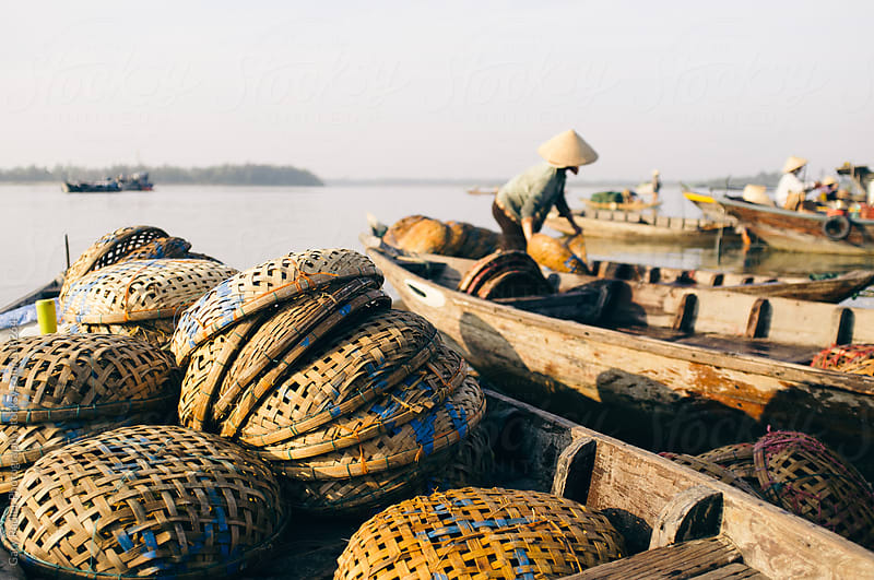 Fish Market Baskets on a Canoe by Gary Radler Photography for Stocksy United
