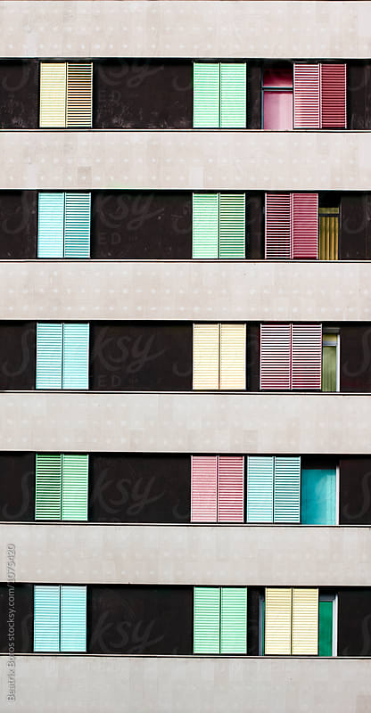 Six floors of a building with several windows by Beatrix Boros for Stocksy United