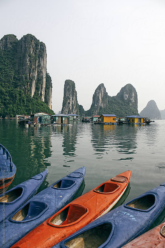 Kayaks on floating village in Halong Bay, Vietnam travel image by Alejandro Moreno de Carlos for Stocksy United