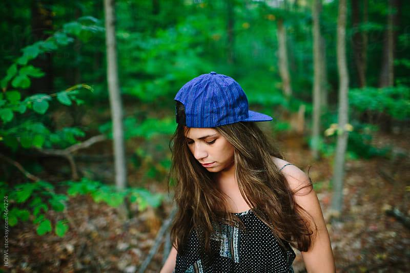 Brunette female hipster walks through wilderness by HOWL for Stocksy United
