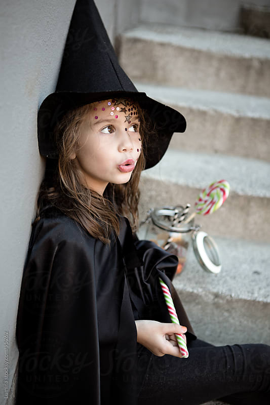 Cute Witch With Halloween Treats by Lumina for Stocksy United