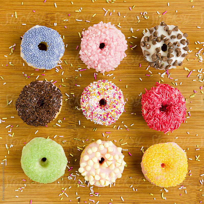 Nine iced doughnuts by Kirsty Begg for Stocksy United