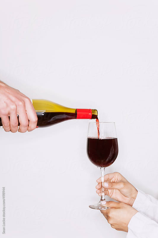 Portraits: Man Pouring Glass Of Red Wine by Sean Locke for Stocksy United
