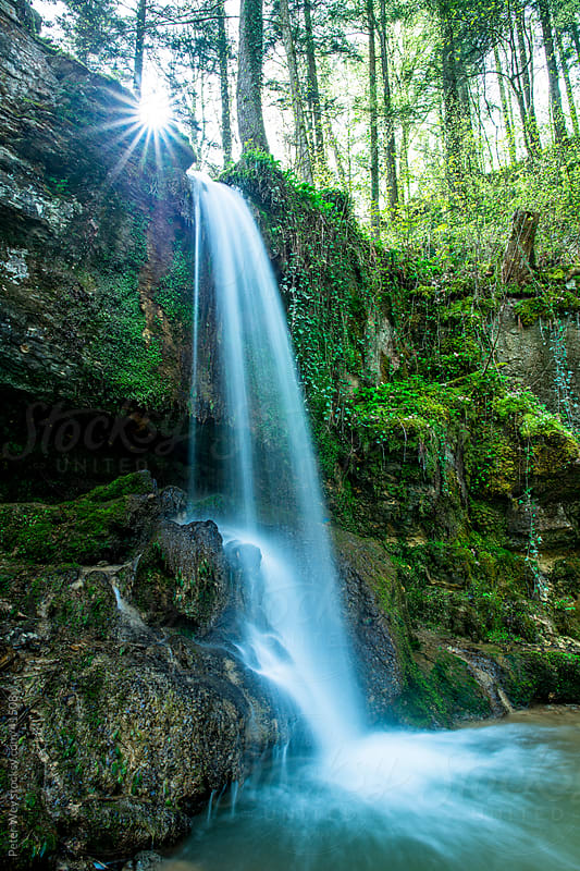 Small Waterfall inside green forest in spring at Linn by Peter Wey for Stocksy United